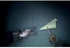 Cкладываем бумажный самолетик с помощью медицинского робота